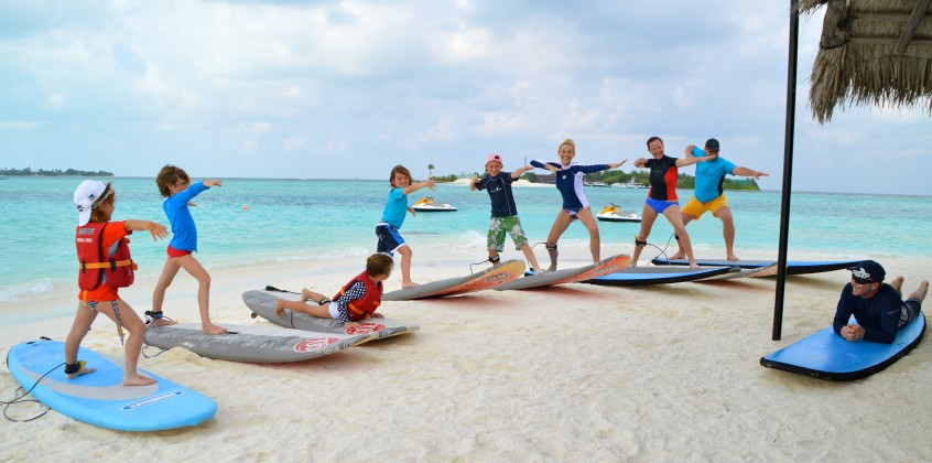 Family surfing lesson with Tropicsurf