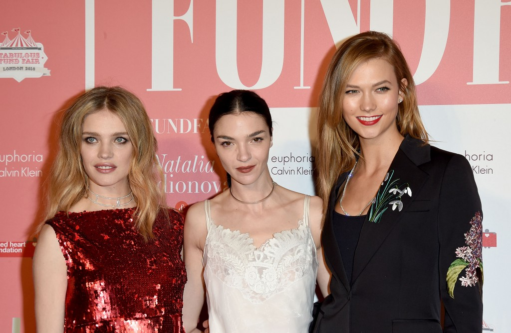 LONDON, ENGLAND - FEBRUARY 20: (L-R) Natalia Vodianova, Mariacarla Boscono and Karlie Kloss at The Naked Heart Foundation's Fabulous Fund Fair in London at Old Billingsgate Market on February 20, 2016 in London, England. (Photo by David M. Benett/Dave Benett / Getty Images for The Naked Heart Foundation) *** Local Caption *** Natalia Vodianova; Mariacarla Boscono; Karlie Kloss