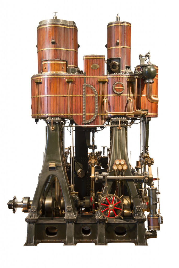 T.1962.10 TECHNOLOGY steam engine model Carlaw, David (maker); Brock, Walter (designer) Scotland, Glasgow, Leven Shipyard, Wm Denny Bros (place of manufacture) 1887 wood; metal; brass overall: 980 mm x 850 mm x 610 mm Steam engine model in glazed case with electric drive. Vertical cylinders encased in timber with brass strips. Cast iron frame in dark grey with full auxiliaries in fine detail. Made by David Carlaw. Model of quadruple expansion tandem engine fitted in the SS Buenos Aires, 1887.