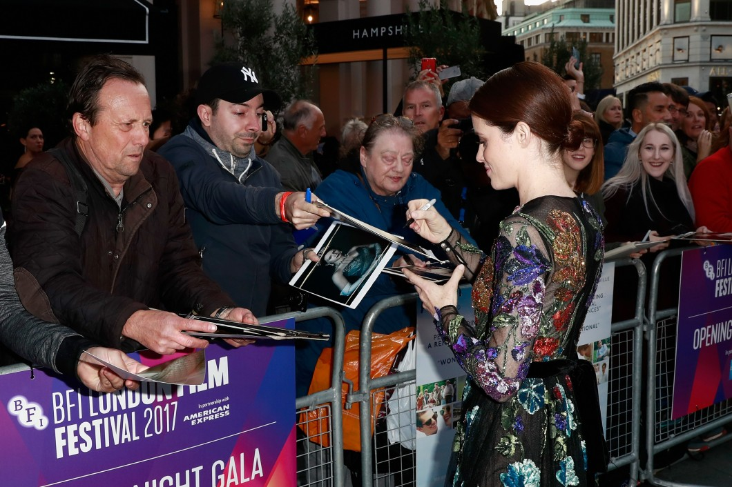 "LONDON, ENGLAND - OCTOBER 04:  Actress Claire Foy signs autographs as she attends the European Premiere of ""Breathe"" on the opening night gala of the 61st BFI London Film Festival on October 4, 2017 in London, England.  (Photo by John Phillips/Getty Images for BFI) *** Local Caption *** Claire Foy"