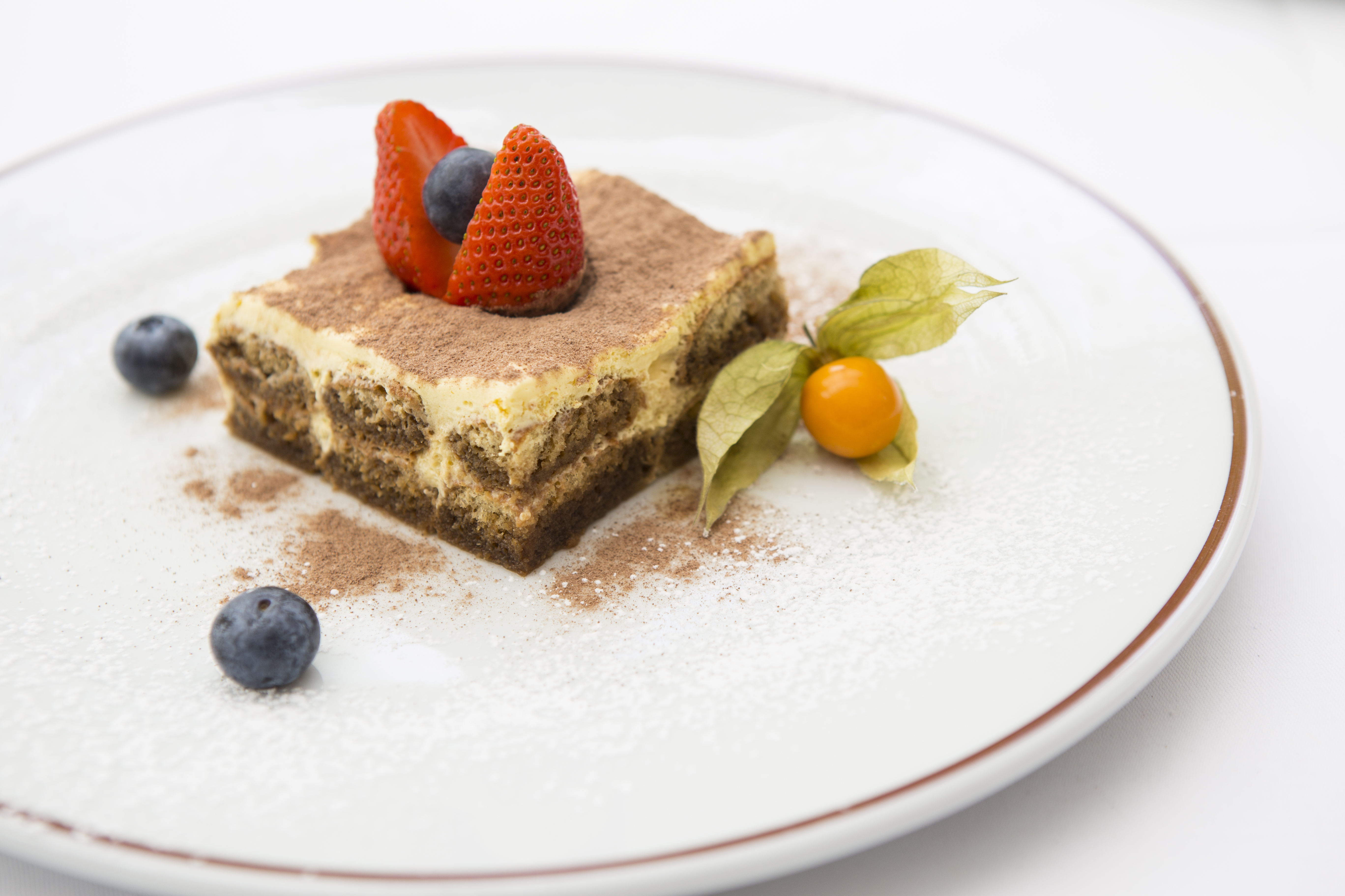 Tiramisu - Savoiardi biscuits lightly soaked in a coffee punch, with mascarpone cheese and amaretto liqueur -£5.5 (1)