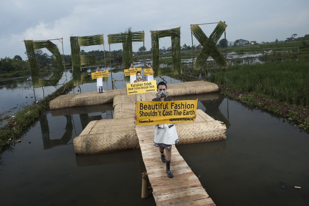 "Indonesian models wear eco fashion apparels designed by Indonesian well known designers Felicia Budi, Indita Karina, Lenny Agustin during ""Detox Catwalk"" organised by Greenpeace in the polluted paddy field in Rancaekek, West Java province to highlight the toxic pollution brought by clothing industry as well as the idea that 'Beautiful fashion shouldn't cost the earth'."